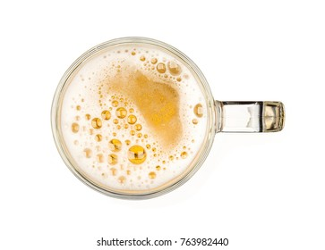 Mug of beer with bubble on glass isolated on white background top view