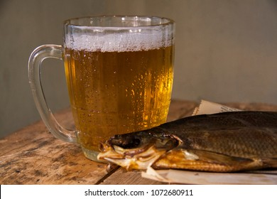 mug of beer with fish