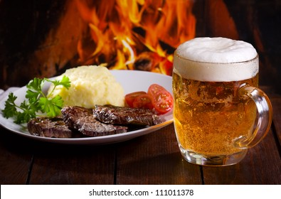 mug of beer and grilled meat
