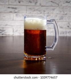 Mug with beer on the table.