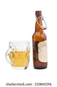 Mug of beer with  open half filled brown bottle of beer