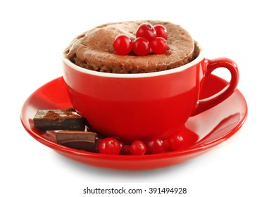 Mug cake with cranberry and chocolate isolated on white