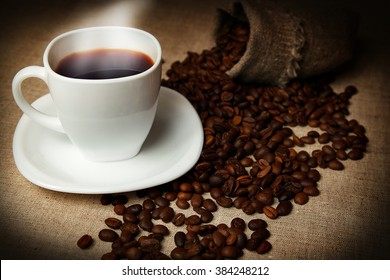 mug of coffee and coffee beans