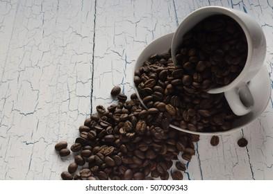 Mug with coffee beans.