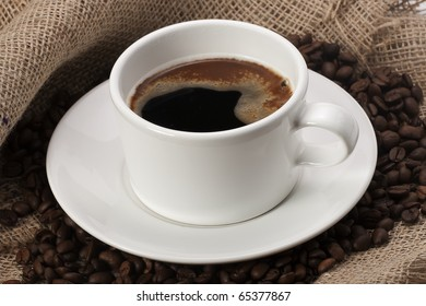 mug of coffee beans and hessian