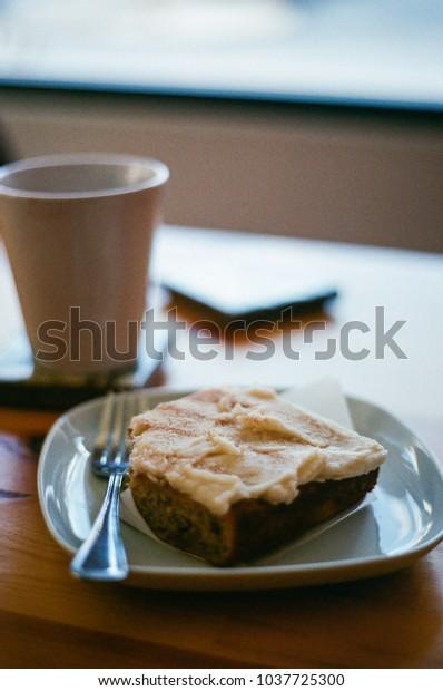 Mug of coffee with cake