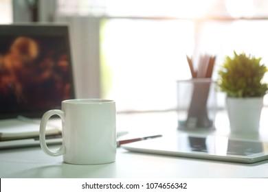 Mug Coffee on business work table.