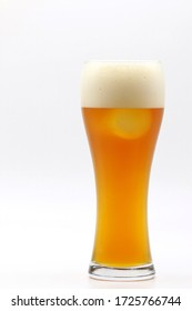 A mug of cold beer with foam in refreshing drinking after working and celebration concept.
