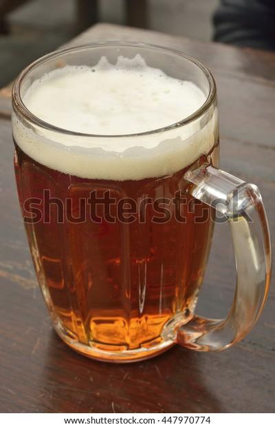 Mug of dark beer.
