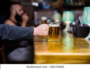 Mug filled with cold tasty beer in bar. Friday leisure tradition. Beer pub concept. Weekend lifestyle. Beer mug on bar counter defocused background. Glass with fresh lager draft beer with foam.