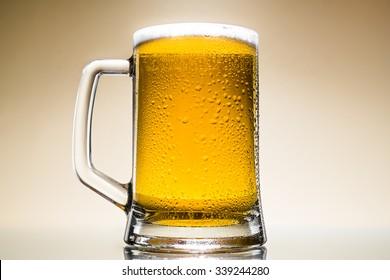 Mug fresh beer with cap of foam