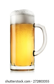 Mug of fresh light beer with foam isolated on a white background