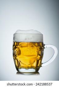 Mug full of fresh beer isolated on white background