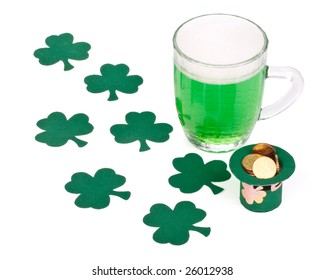 Mug of Green beer, shamrock and Leprechaun hat with coins for St Patrick's Day