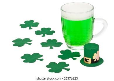 Mug of Green beer, shamrock and Leprechaun hat for St Patrick's Day
