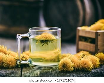 Mug of healthy dandelion tea. Therapeutic drink. Phytotherapy. Retro tinted.