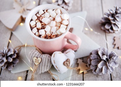 Mug of hot chocolate with candy marshmallows on table, top view
