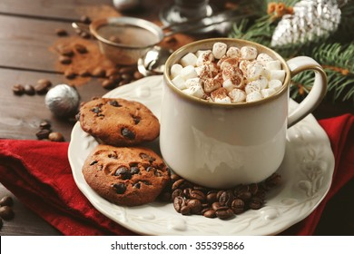 Mug of hot chocolate with marshmallows, fir tree branch on wooden background