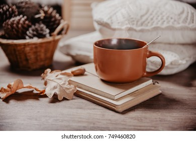 mug with a hot drink, toned image, the concept of coziness and autumn mood