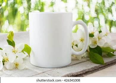 Mug mockup with apple blossom. Mug mockup. Coffee cup template. Blank mug printing design template. White mug mockup. Cup mockup.
