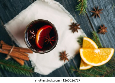 A mug of mulled wine with cinnamon, anise and citrus