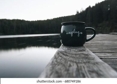 mug on the dock at the lake