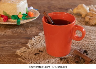 Mug of Quentao (traditional drink in the Festa de Sao Joao), on the rustic wooden table. It's Junina Party Time! Northeast of Brazil.