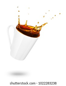 mug of spilling coffee or tea with splash isolated on white background