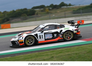 Mugello Circuit, Italy - October 2, 2020: Porsche 991 GT3 of Team Dinamic Motorsport driven by Cassarà Marco - De Giacomi Alex in action during Qualifyng session of Italian Championship GT.