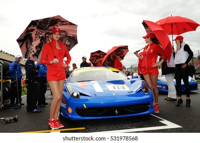 MUGELLO, IT, November, 2011: Unidentified Pit Babes pose for photos in the paddock during Finali Mondiali Ferrari 2011 at the Mugello Circuit in Italy