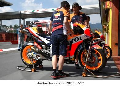 MUGELLO - ITALY, 2 JUNE: Mechanics work on Honda RC213V 2018 of Repsol Honda Team - in the Pit Lane at 2018 GP of Italy in Mugello Circuit. Italy.