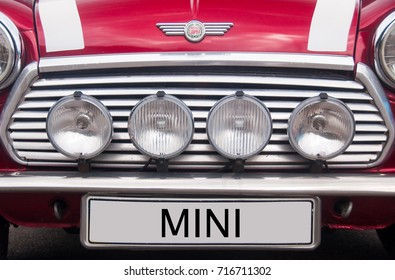 Mugello, Italy - May, 2013: Classic logo of Mini Cooper car. Front grill with additional lamps and logo of Classic Mini Cooper car.