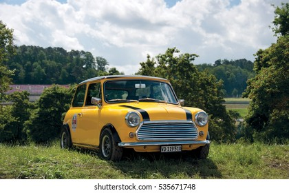 Mugello, Italy - May, 2013: Yellow classic Austin Mini Cooper retro vehicle parked on the green lawn at the International Mini Meeting 2013 in Mugello, Italy.