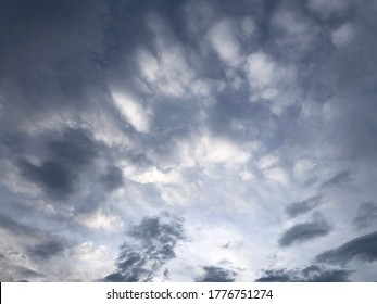 Muggy weather atmosphere in evening summer. Soft dark rainy cloudy behind blue sky. Moment of planet climate change. Rainy sky day.