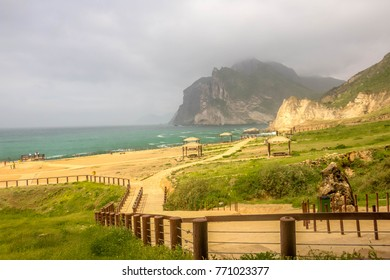 Mughsayl beach and Lush Green Mountains Landscape of Salalah, Sultanate of Oman