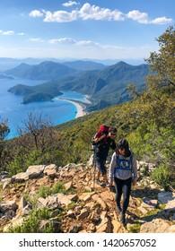 Mugla, Fethiye / Turkey - April 22 2019: Young couple is hiking around beautiful view in Fethiye.