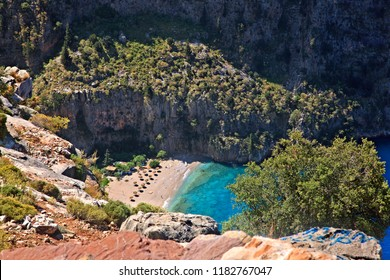 "MUGLA PROVINCE, LYCIA, TURKEY. The beach at the exit of ""Butterfly Valley"" (Kelebekler Vadisi), part of the ""Lycian Way""."