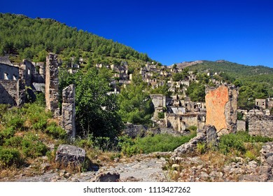 "MUGLA PROVINCE, LYCIA, TURKEY. Partial view of the ""ghost village"" of Kayakoy. The village under the nickname ""Eskibahce"" appears in the novel ""Birds without wings"", by Louis de Bernieres."