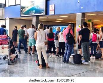 Mugla, Turkey - June 22, 2018; People waiting their luggages in Bodrum airport domestic terminal of Mugla in Turkey