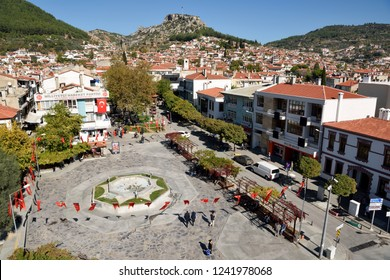 Mugla, Turkey - November 6, 2018. View over Mugla, with the Main Square, residential buildings, commercial properties and people.