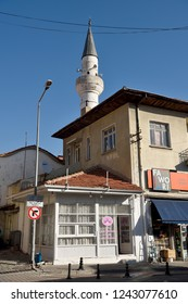 Mugla, Turkey - November 7, 2018. Street view in Mugla city, Turkey, with residential buildings, commercial properties and minaret of Seyh cami mosque.