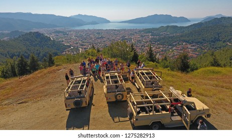 Mugla/Marmaris, Turkey - 10 September, 2017: People are making safari jeeps during the tourist season in Marmaris with Marmaris landscape
