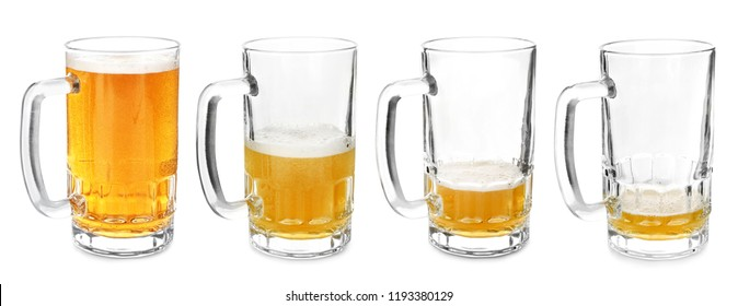 Mugs with different amount of beer on white background