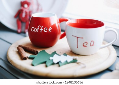 Mugs with tea and coffee on a wooden tray. Christmas decoration. Winter, New Year, Christmas concept.