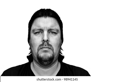 Mugshot of a man with a serious, sad or mean look on his face