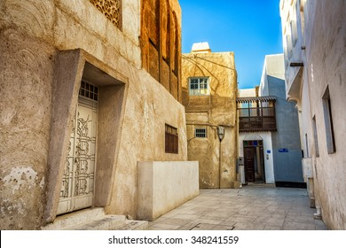 MUHARRAQ, BAHRAIN - 15 NOVEMBER, 2015: An alleyway and buildings in the restored area of Muharraq the old capital of Bahrain.
