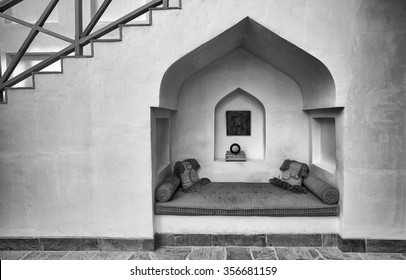 MUHARRAQ, BAHRAIN - 19 DECEMBER 2015: Black and white view underneath some stairs where an alcove in a restored building in Muharraq, the old capital of Bahrain, provides a welcome retreat.