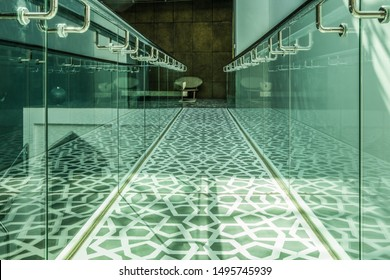 MUHARRAQ, BAHRAIN - FEBRUARY 10, 2018:  Light shines onto a balcony walkway decorated with islamic geometrical patterns in a museum in the middle east.