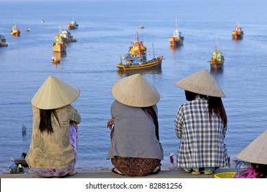 MUI NE, VIETNAM - APRIL 16: Unidentified women await returning fishing boats in Mui Ne, Vietnam at sunrise on April 16, 2011.  Vietnam seafood export is expected to reach $6.5bl USD by 2015.