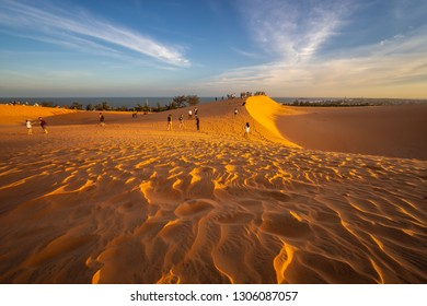 MUI NE, VIETNAM - JANUARY 18, 2019 : Unidentified tourists are traveling red sand dunes in Binh Thuan near the town of Mui Ne, Vietnam. Mui Ne is popular travel destination with long coastline.